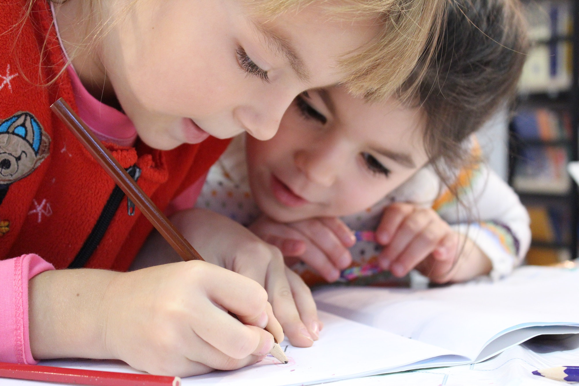 girls-writing-notebook-learning-cube academy-best-summer-camp-plano-texas